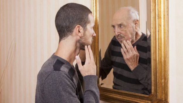 Ageing Man in Mirror